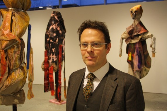 Pontus Kyander amongst art works by Sten Are Sandbeck, in the exhibition 'Fashion Ghost' at TKM