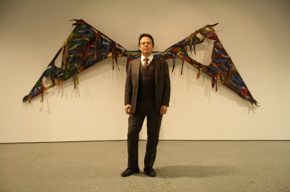 Pontus Kyander in front of a piece by Sten Are Sandbeck